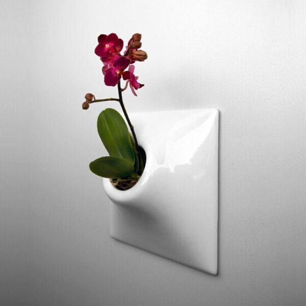white ceramic wall planter
